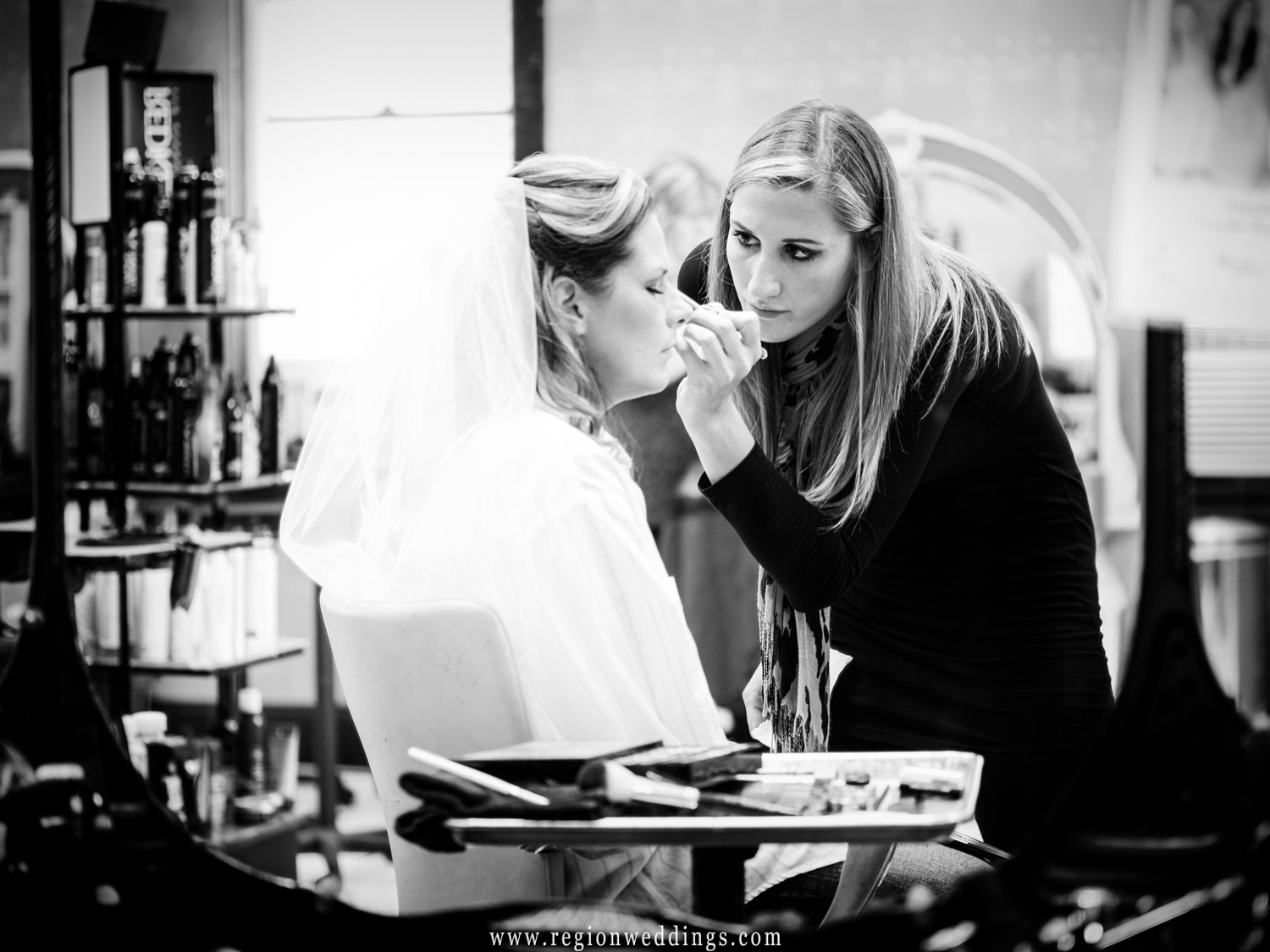 The bride gets her make up done at Downtown Hair Studio in Lowell.