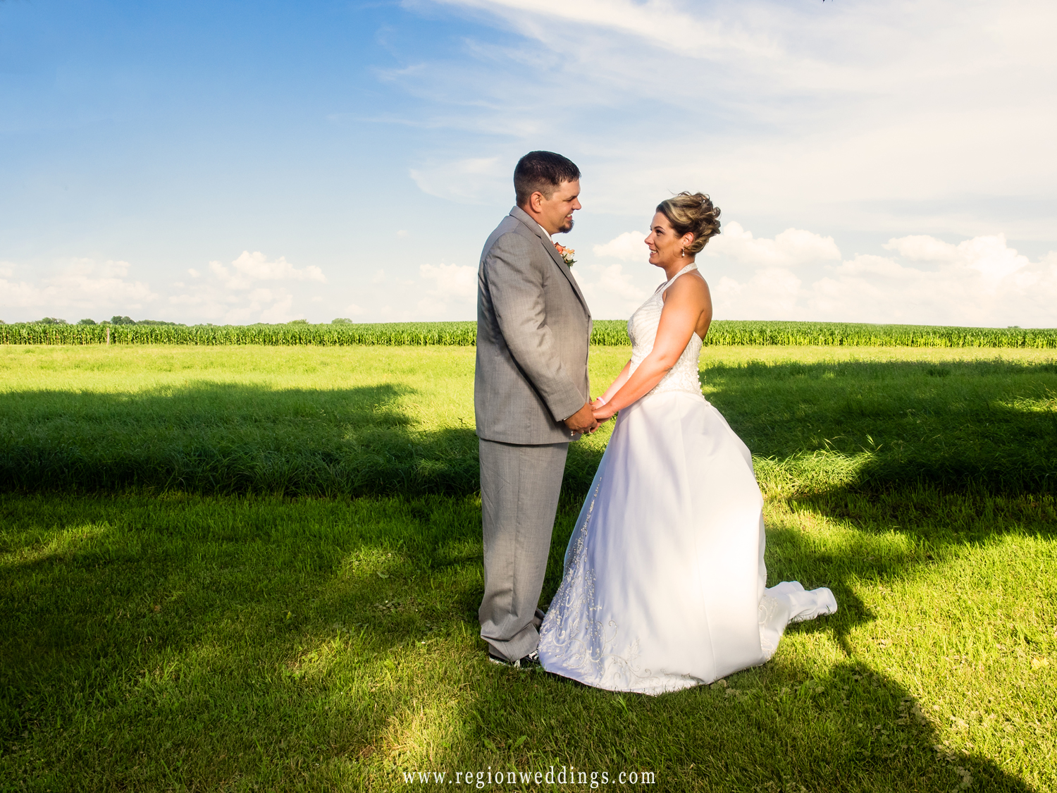 The newly married couple gaze at each other with Indiana farmland as a backdrop.