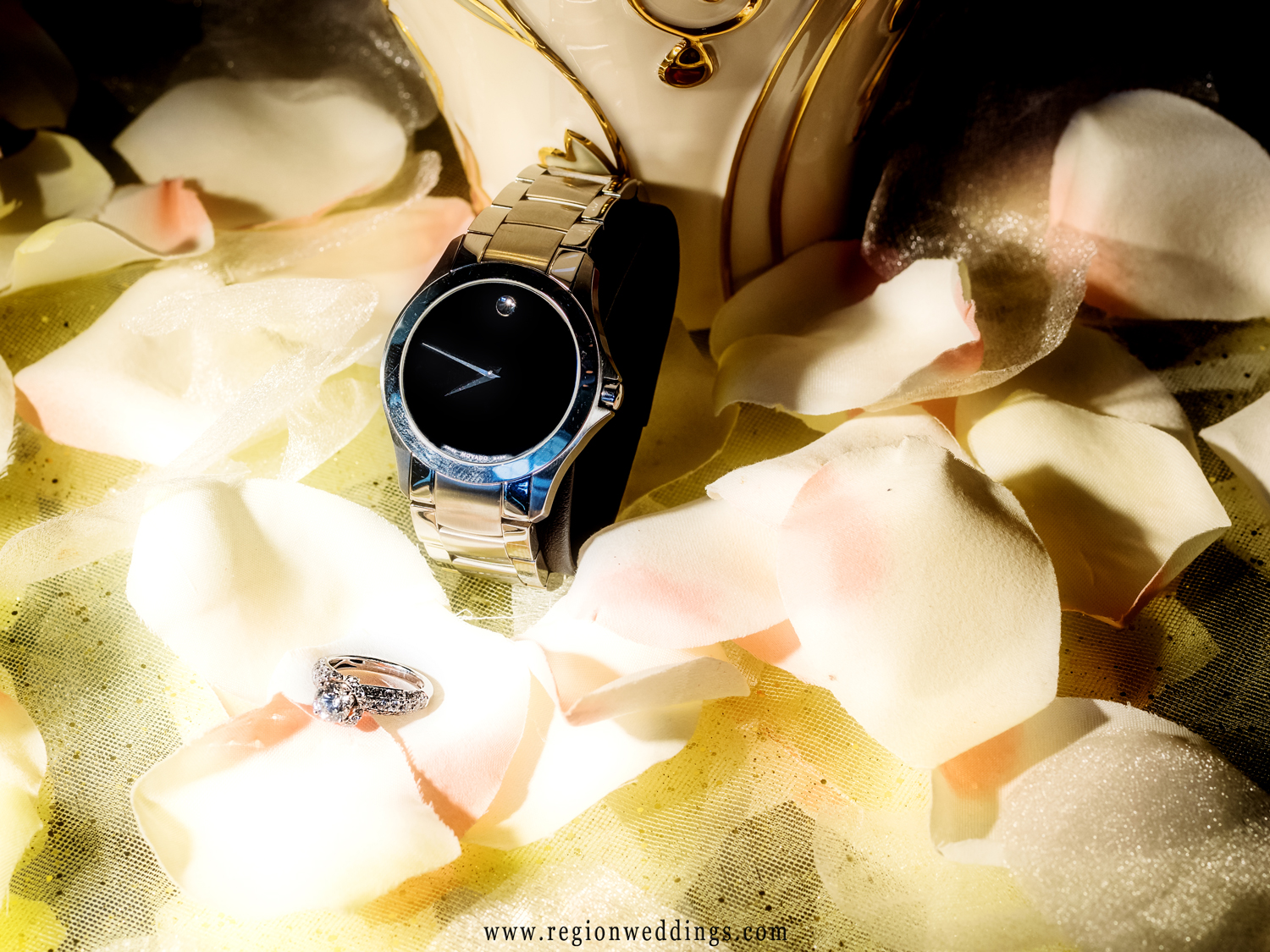 An engagement ring and luxury Swiss watch.