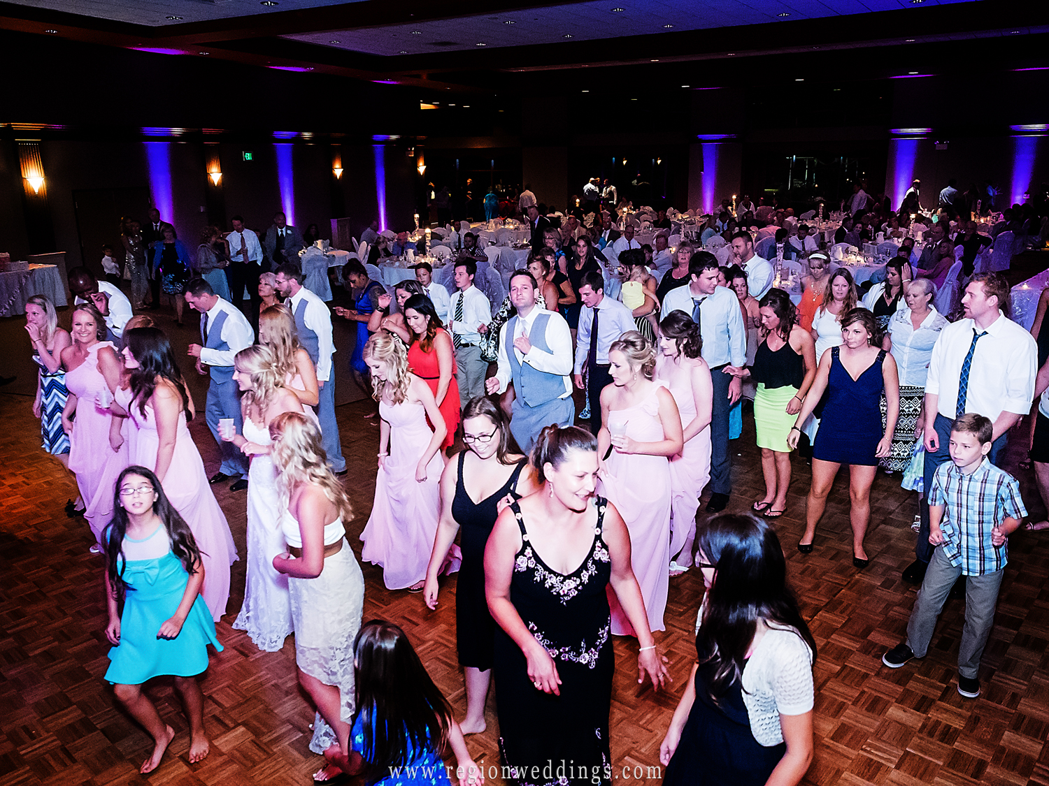 The dance floor is filled to capacity at the Halls of St. George Banquet Hall.