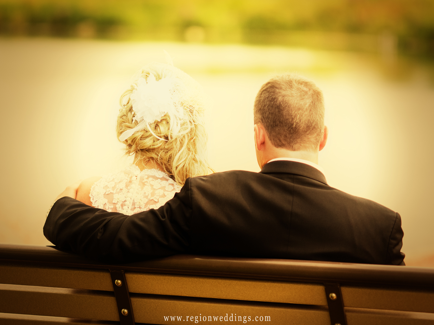 Late afternoon sun engulfs the happy couple after their wedding ceremony.