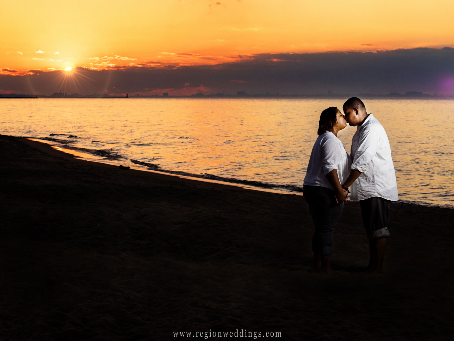 Sunset engagement photo off of Lake Michigan.