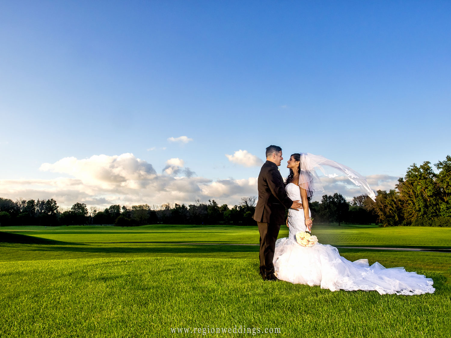 The bride's veil flies in the wind at Sand Creek Golf Course in Chesterton, Indiana.