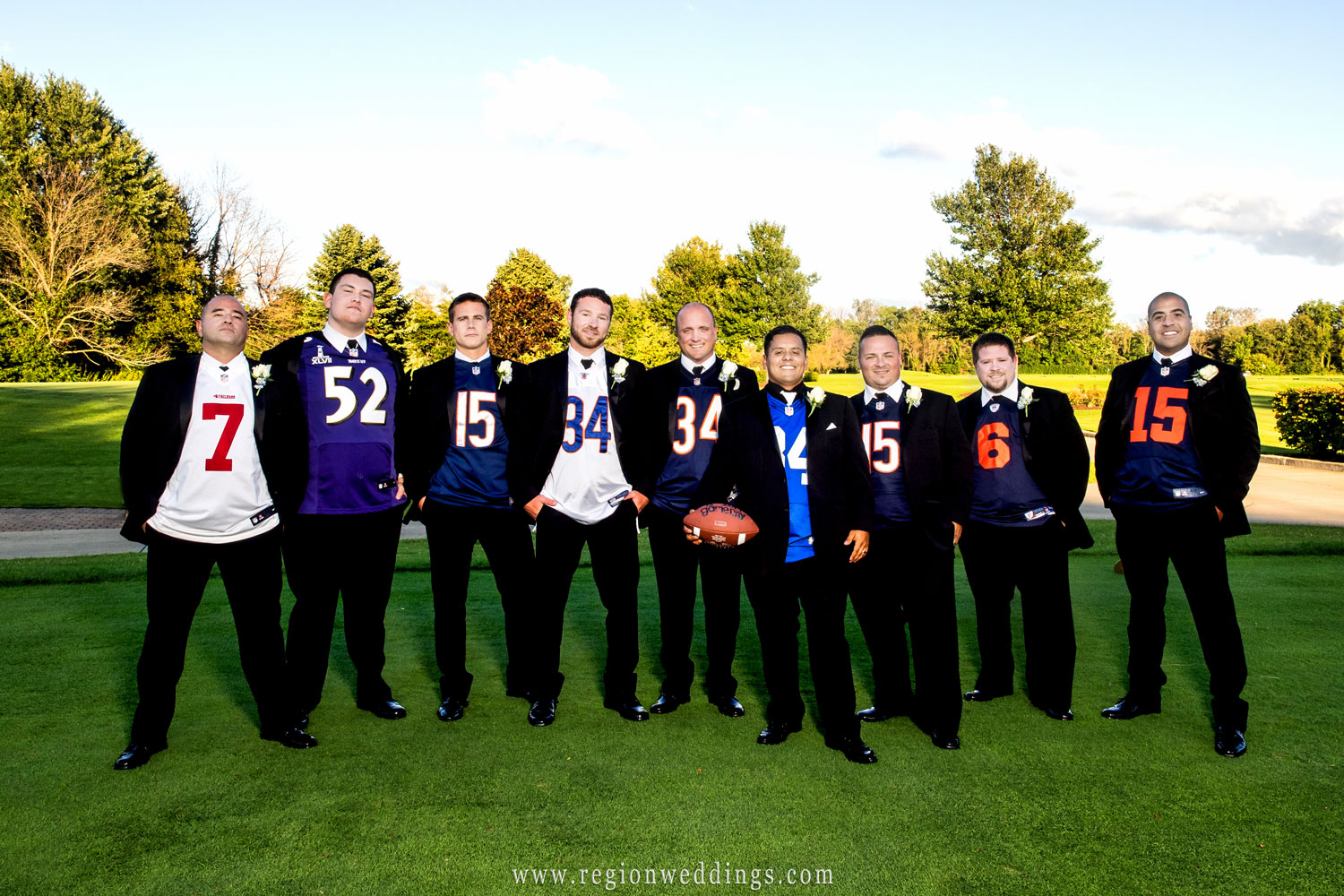 The groomsmen wear the jersey to their favorite football team for a fun wedding photo.