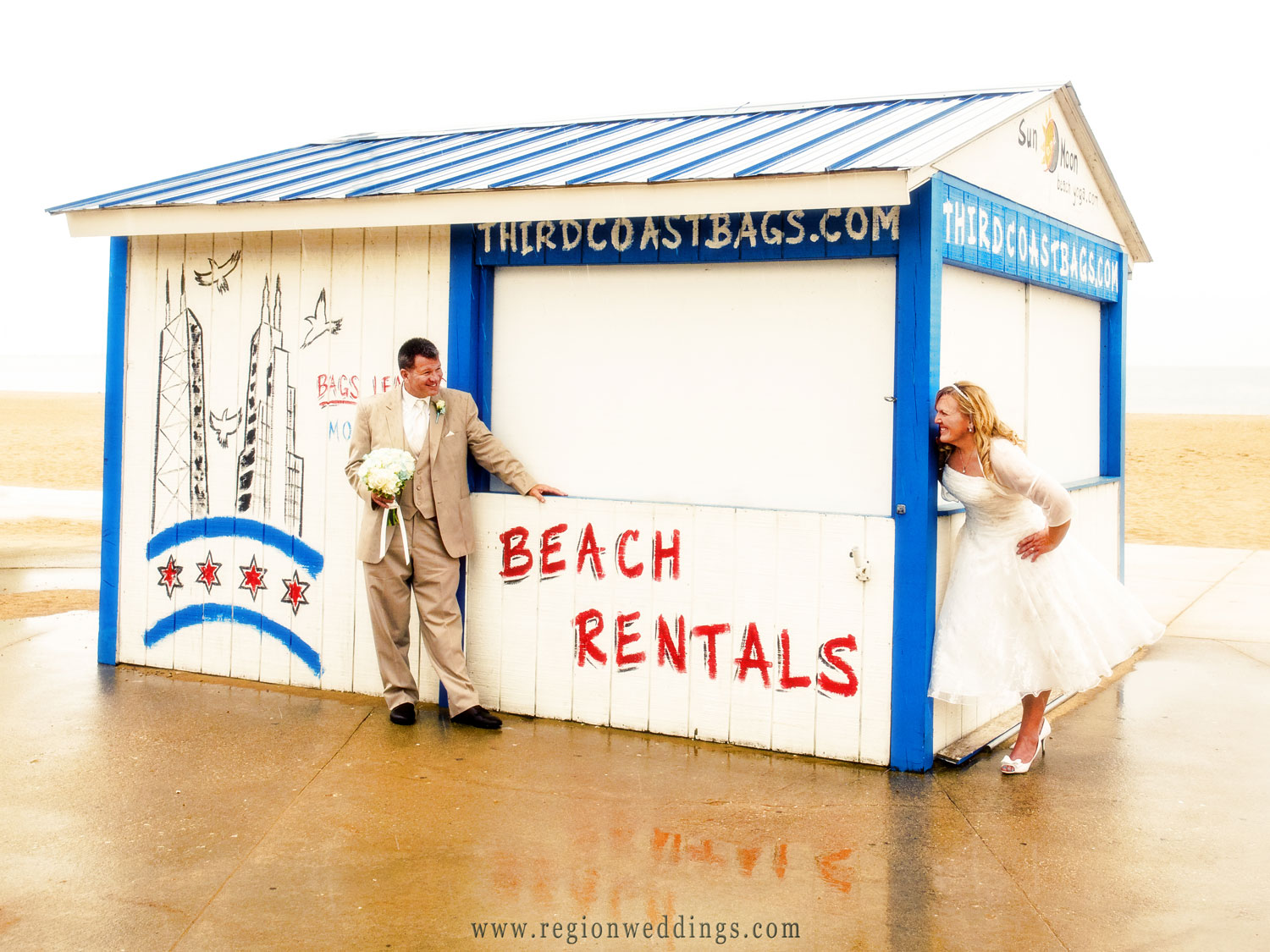 The bride and groom playing peekaboo along North Street beach in Chicago.