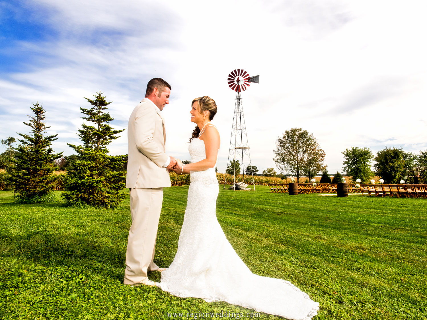 Bride and groom in front of the windmill at Red Barn.