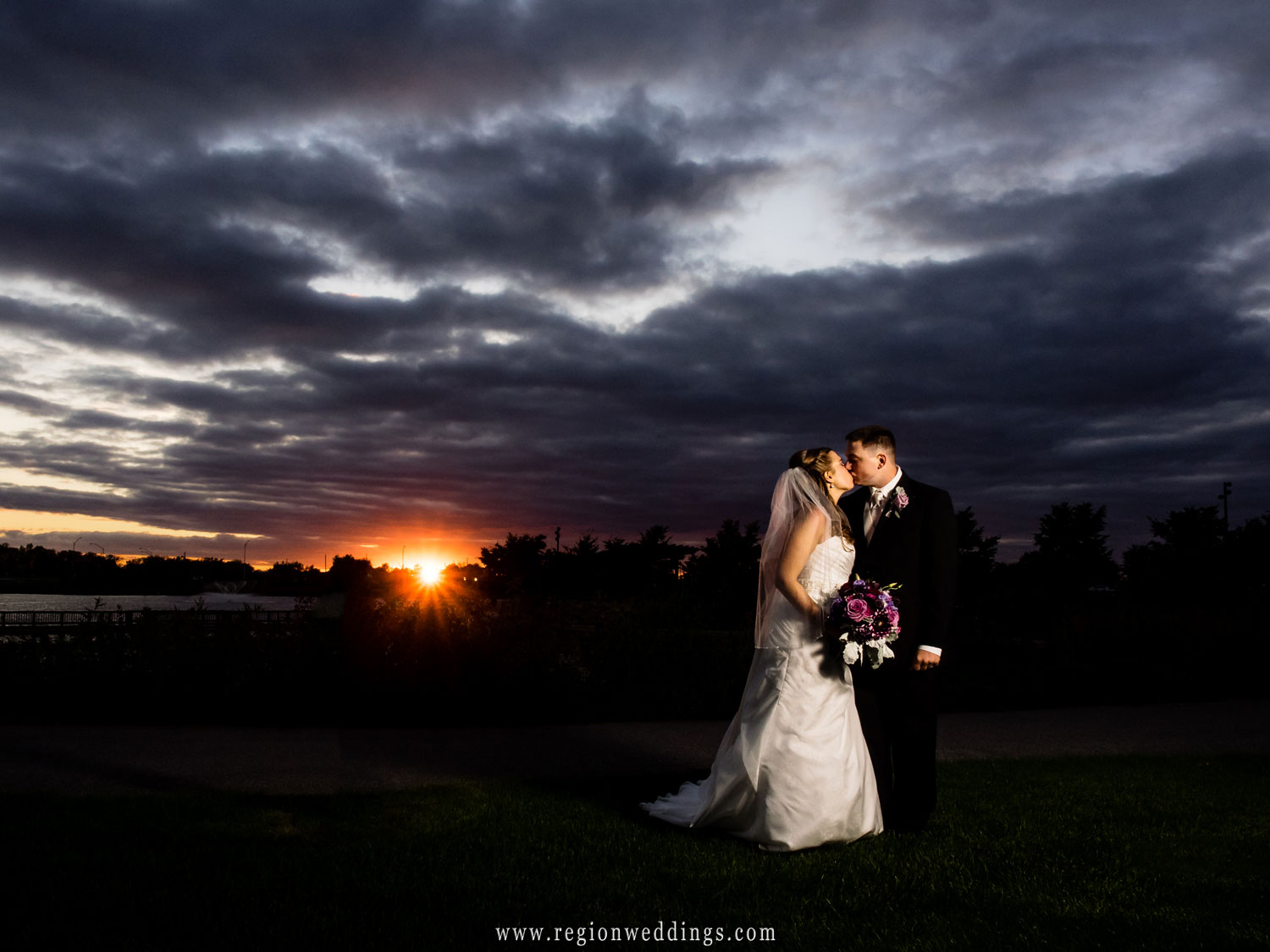 A romantic kiss at sunset at Centennial Park in Munster, Indiana.