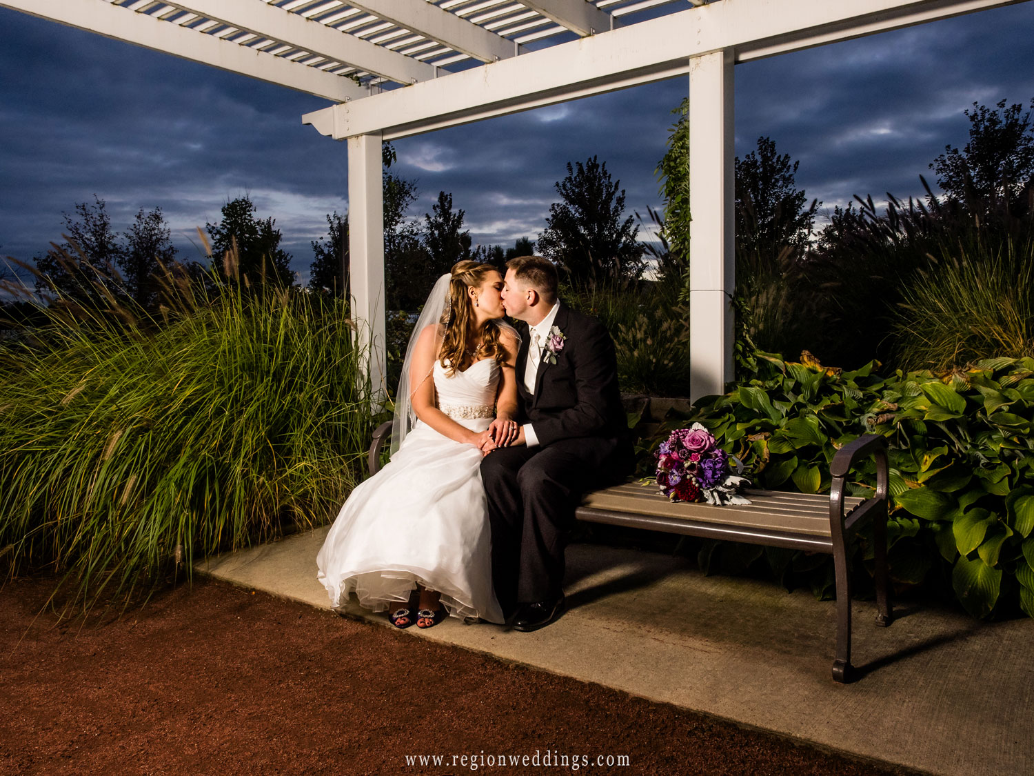 An evening kiss inside the Centennial Garden area.