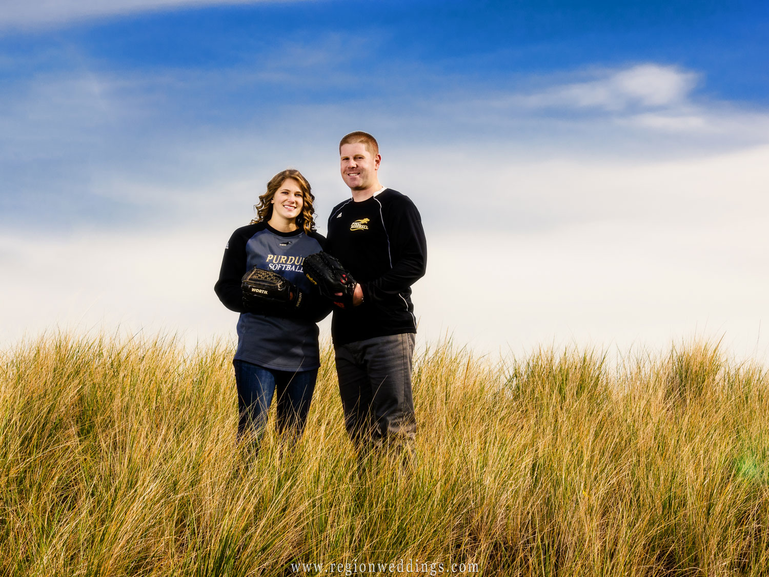 A couple shows off Purdue pride in their engagement photo at the Indiana Dunes.