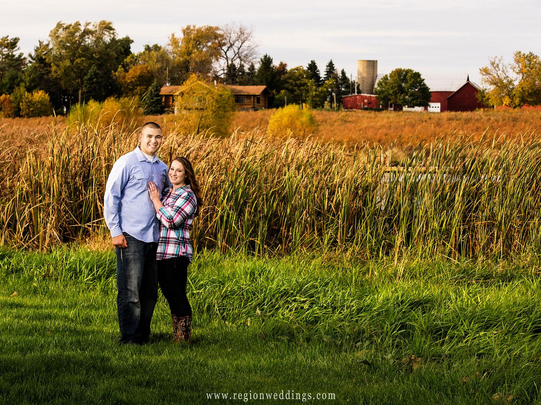 An engagement portrait taken on a midwest farm.