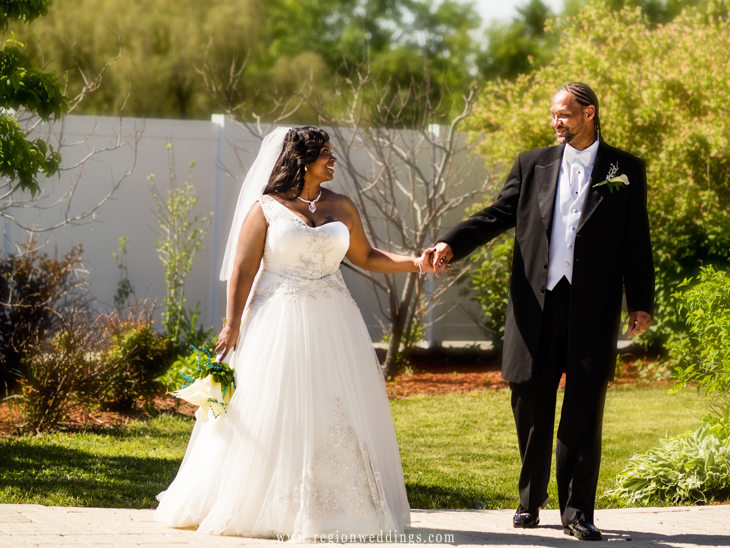 A newly married couple takes a stroll in the outdoor area at The Patrician in Schererville, IN.