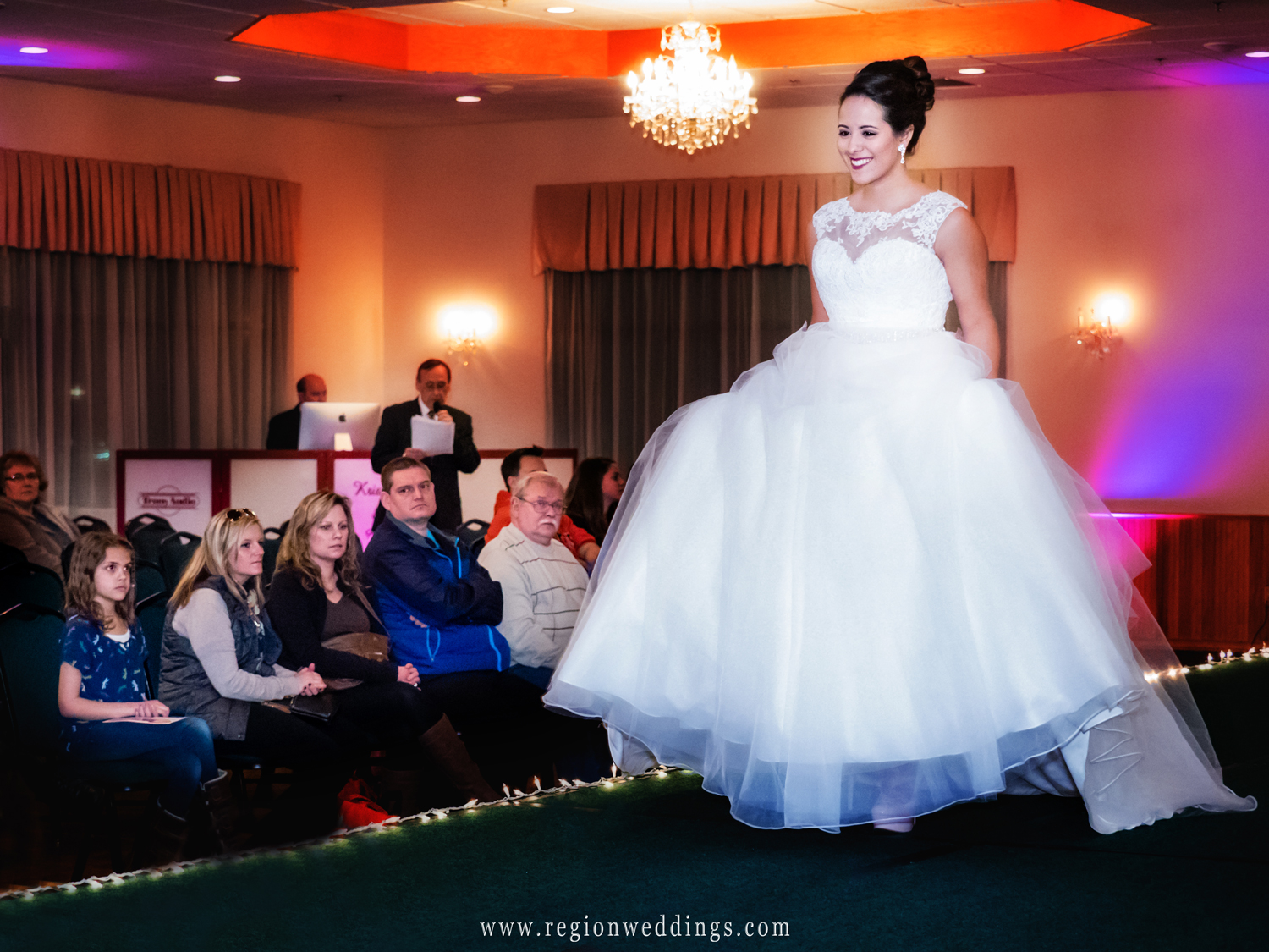A model shows off a wedding dress on the runway at The Patrician Spring Bridal Show