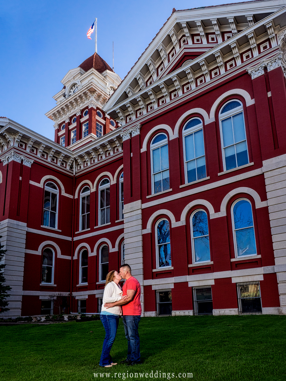 Kissing in front of the Old Courthouse in Crown Point.
