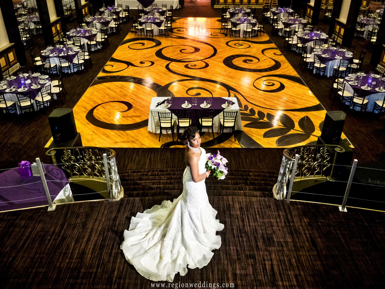 The bride overlooks the majestic ballroom of The Allure in Laporte, Indiana.