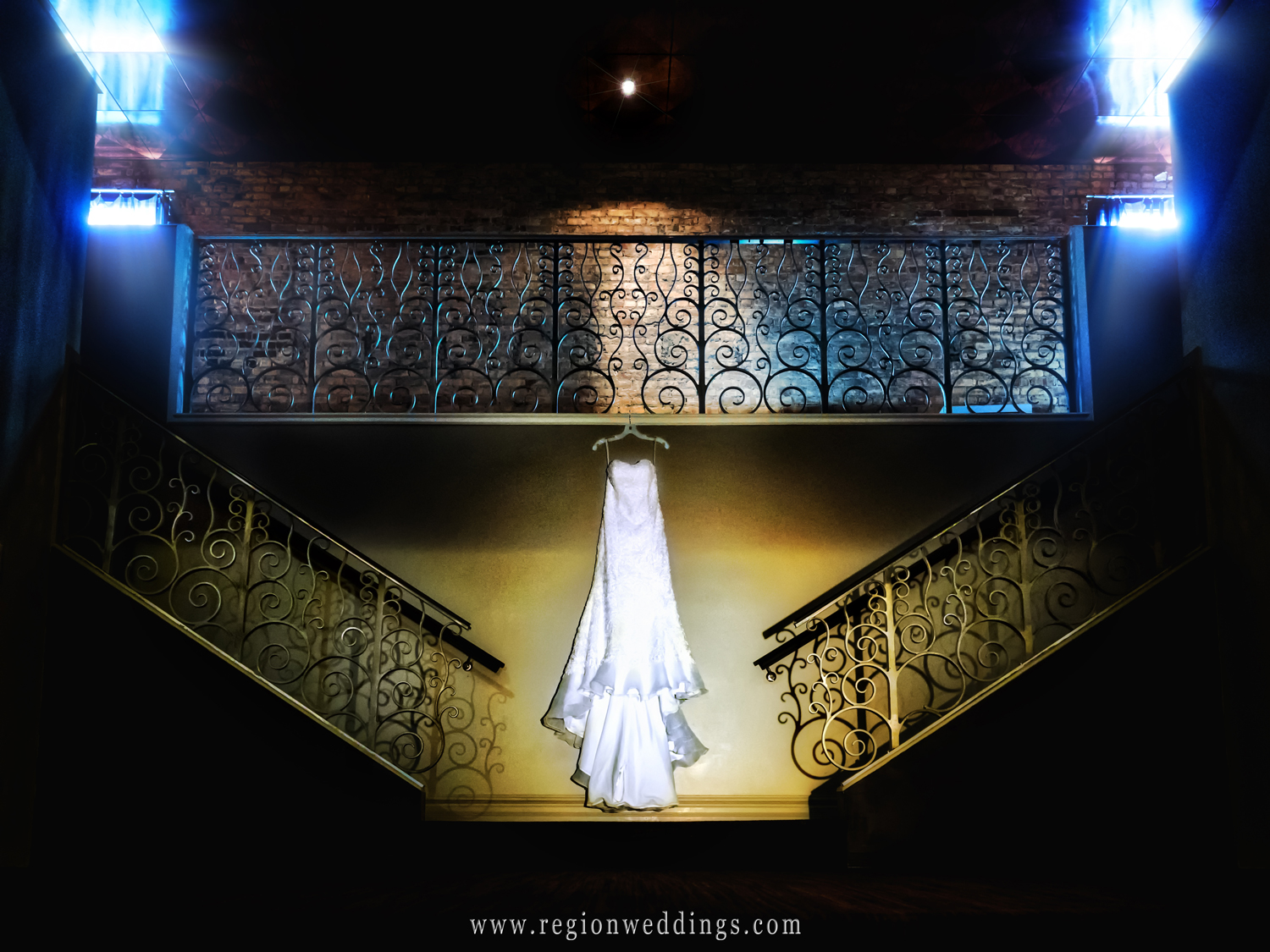 The wedding dress hangs at the bottom of the staircase at The Allure.
