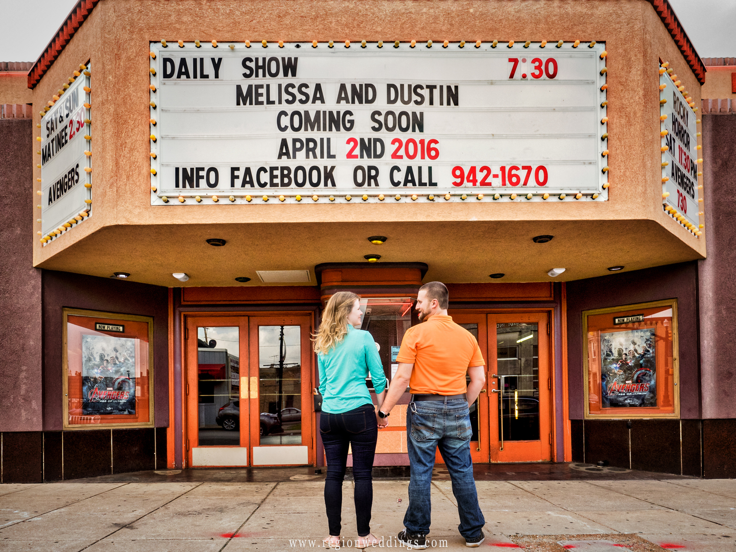 An engaged couple's names adorn the marquee at the Art Theater.