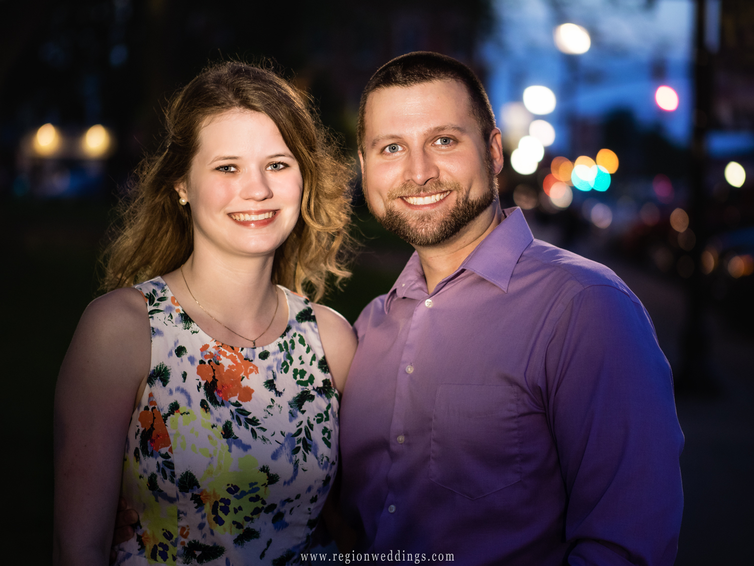 A couple enjoys the night life in downtown Crown Point.