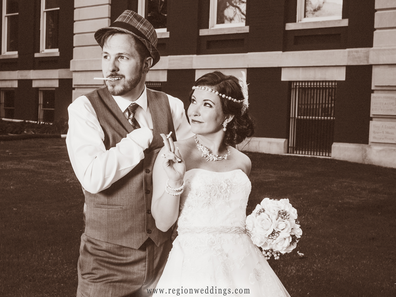 The bride and groom as gangsters on the run at their 1920's themed wedding.