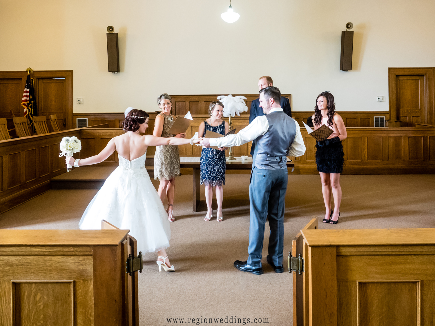 The bride and groom dance at their Crown Point wedding ceremony inside the 3rd floor courtroom.