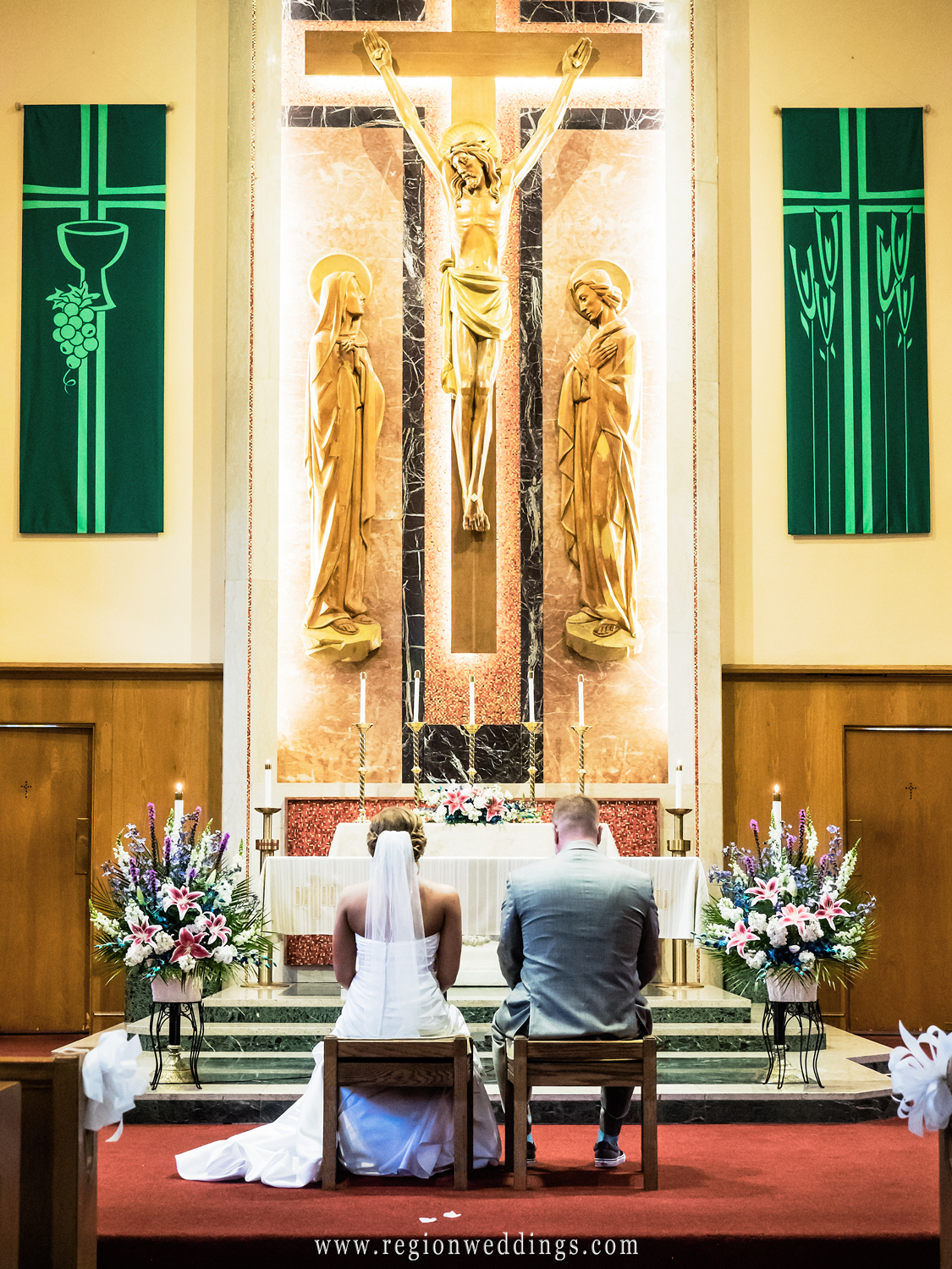 The bride and groom get married at Our Lady of Sorrows Church in Valparaiso, IN.