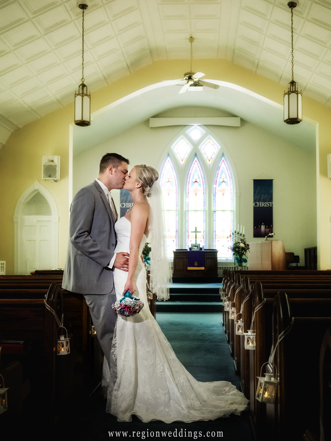 Bride and groom kiss at United Methodist Church in Hebron.