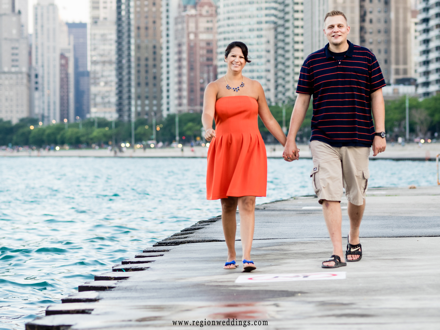 A couple strolls down the boardwalk at North Avenue Beach in Chicago.