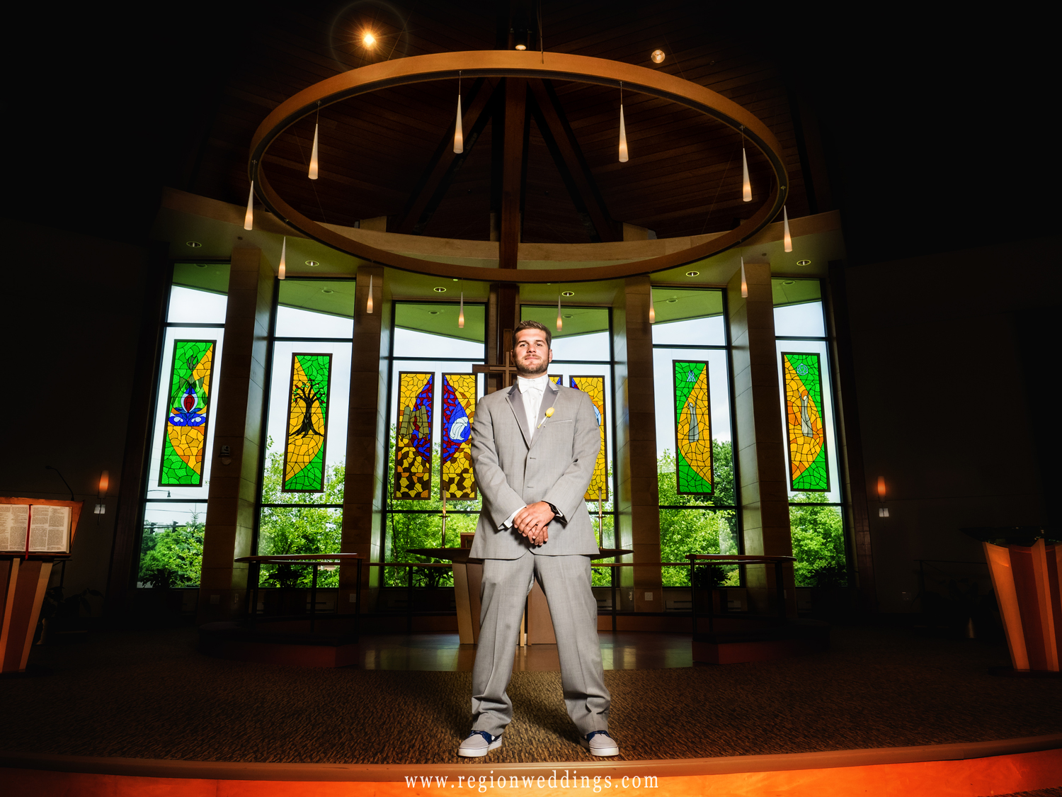 The groom stands tall at the altar of Christ Lutheran Church.