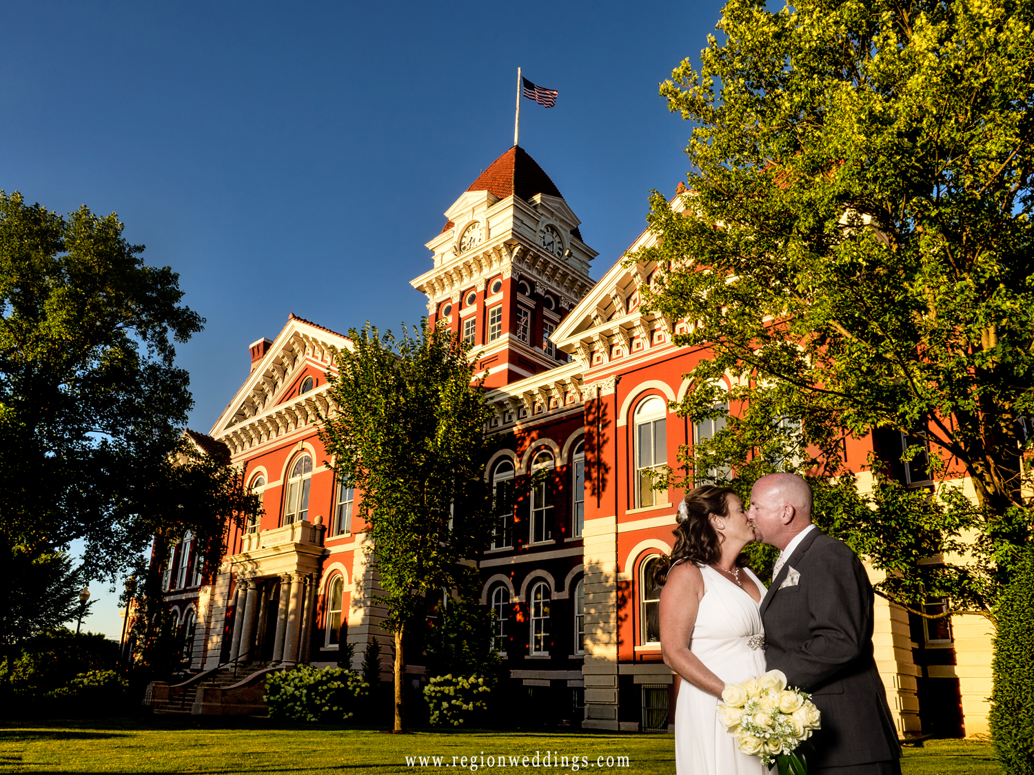 Bride and groom photo in front of the Old Crown Point Courthouse.