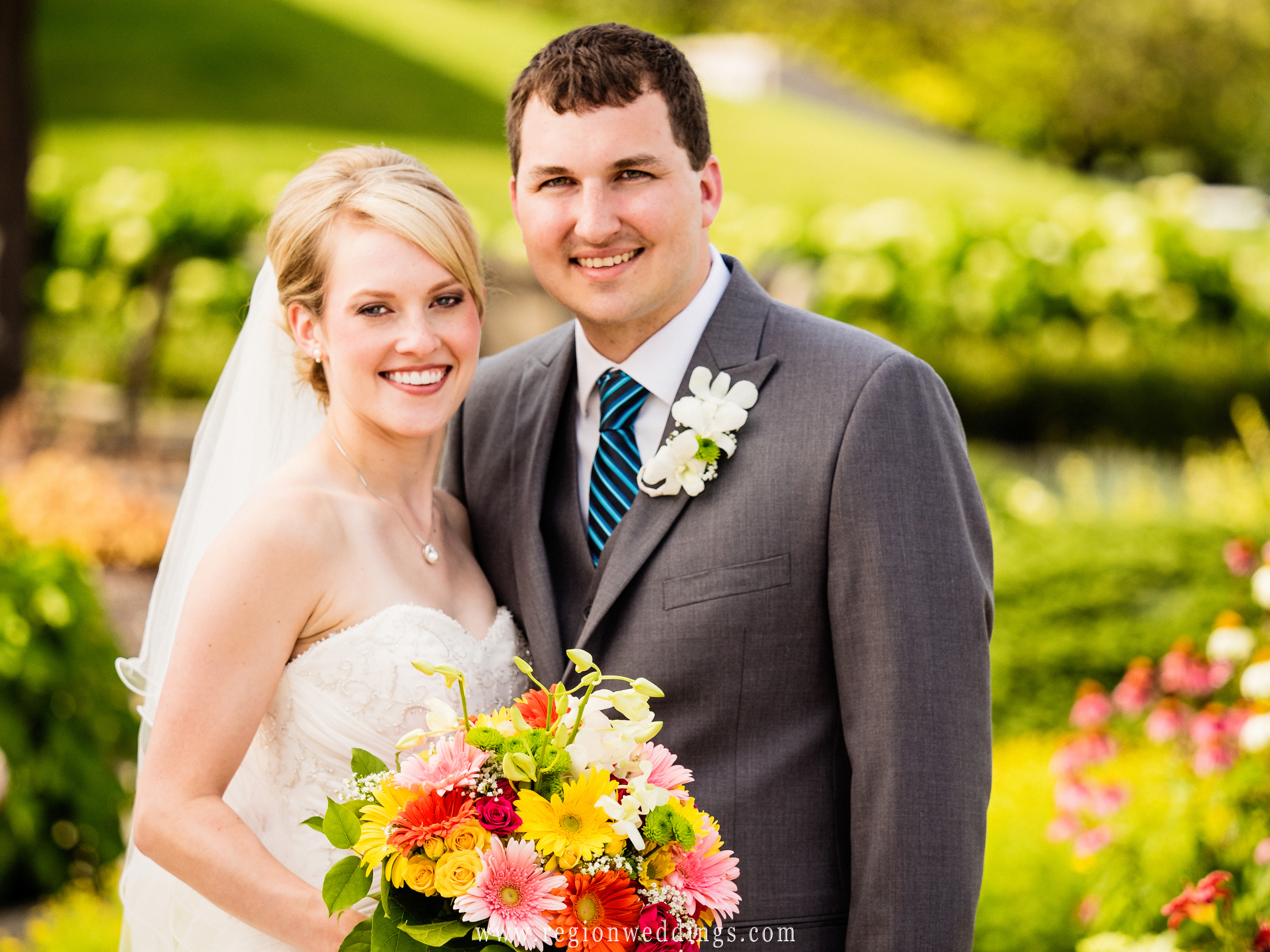 Bride and groom in the garden at Sand Creek Country Club.