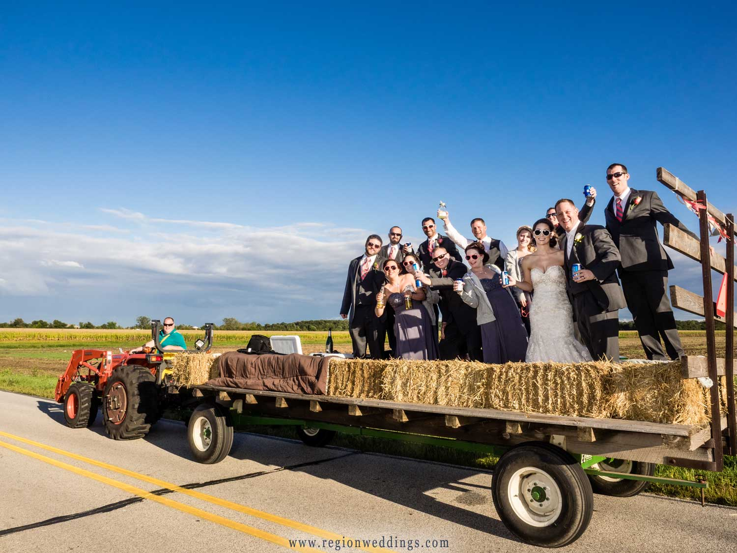 The wedding party on a hayride through the backroads of Lowell, Indiana.