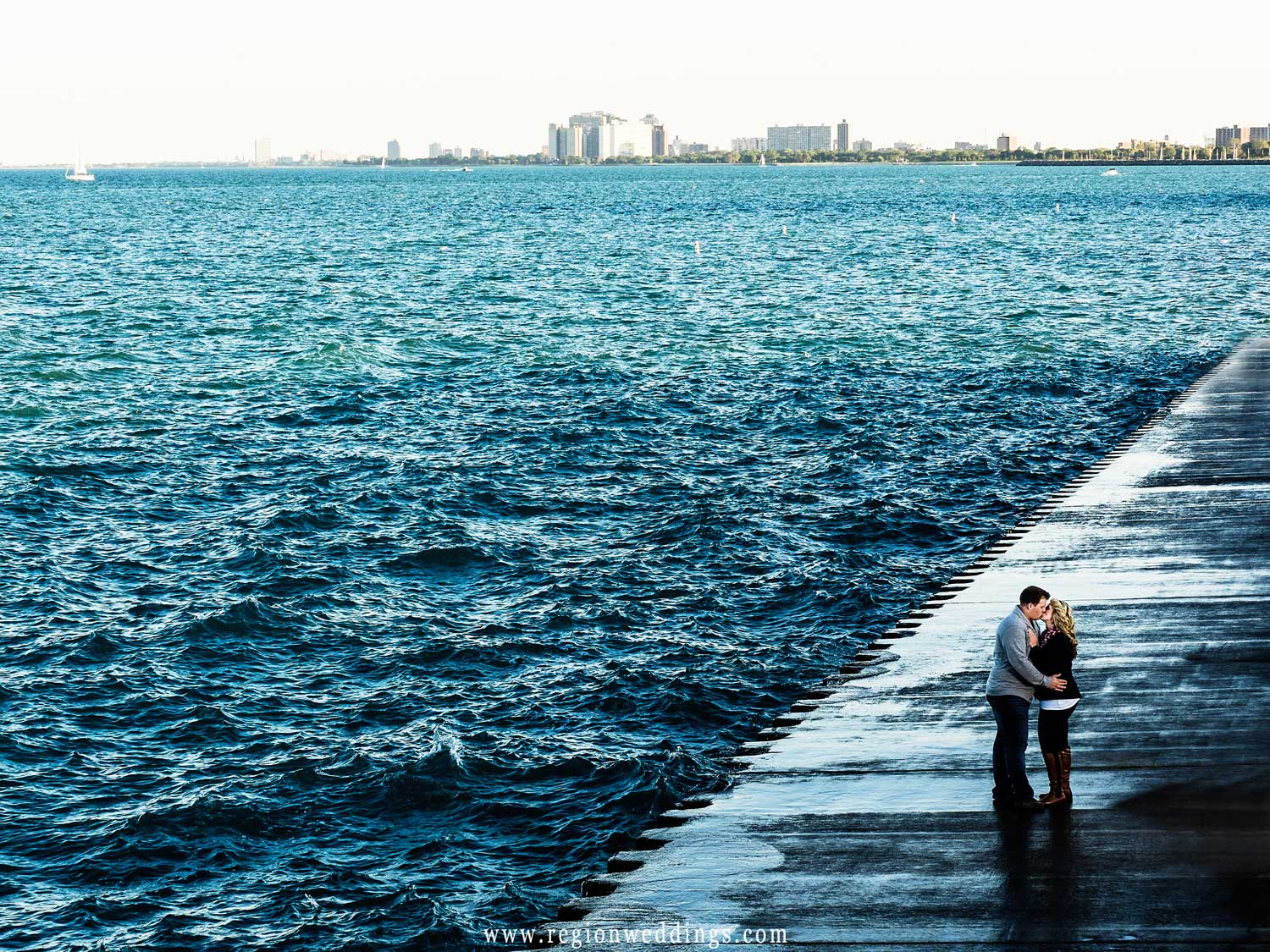 A couple embraces along the water of Lake Michigan in downtown Chicago.
