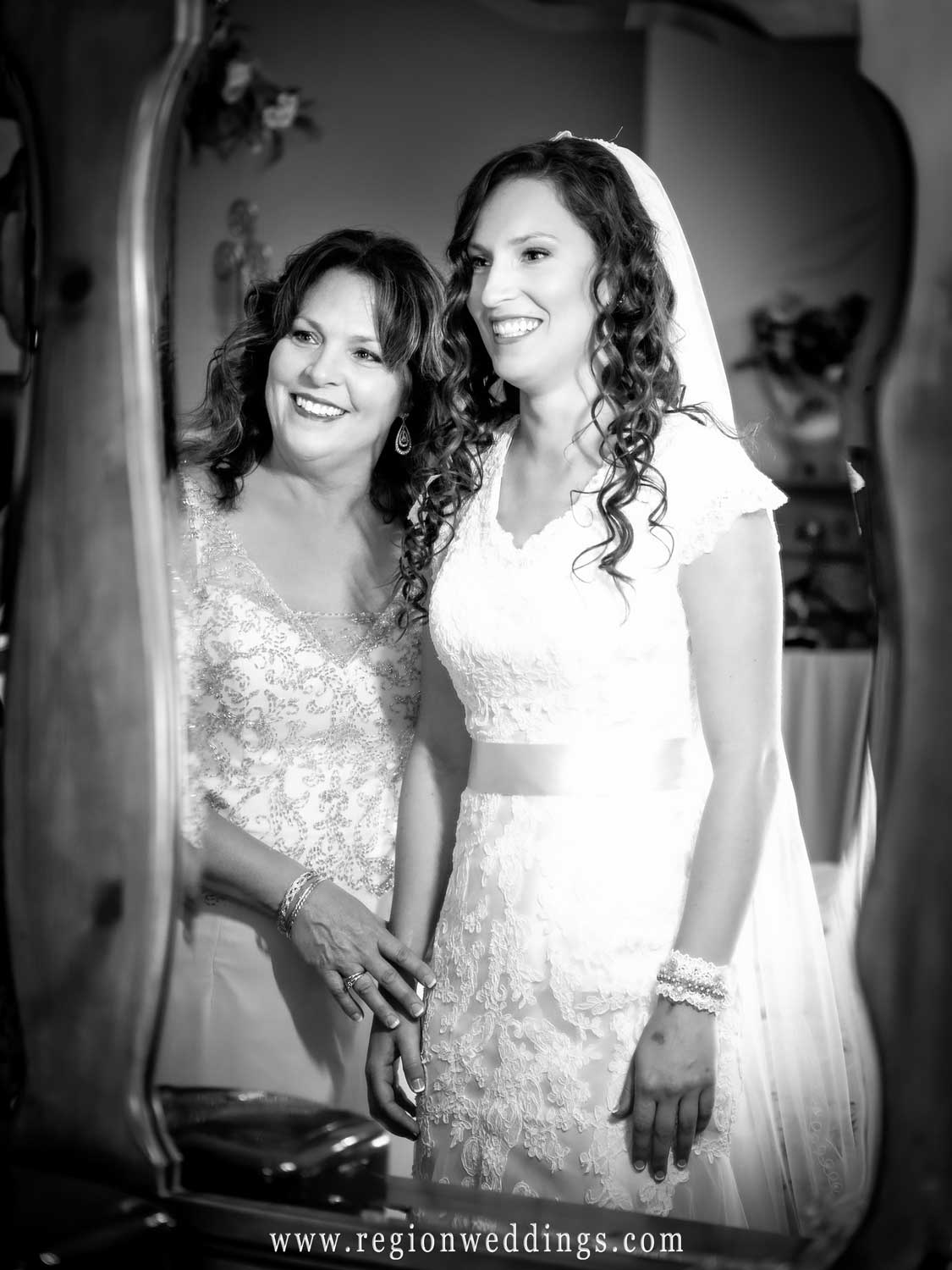Mom and bride share a moment on wedding day.