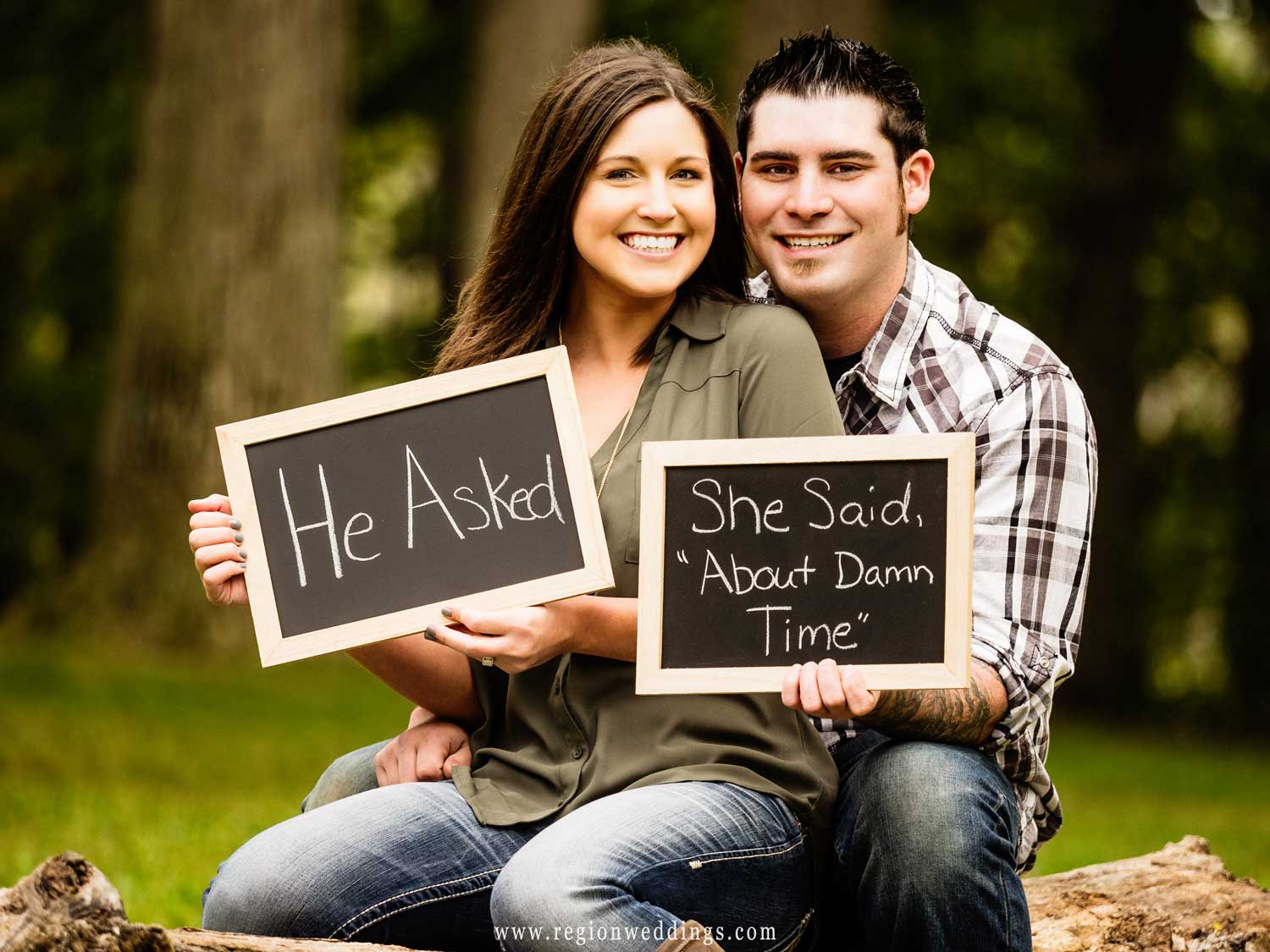 Engagement photo with fun signs.