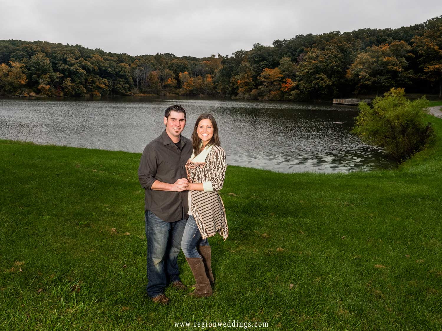 A recently engaged couple in front of Lemon Lake with Fall color in the trees.