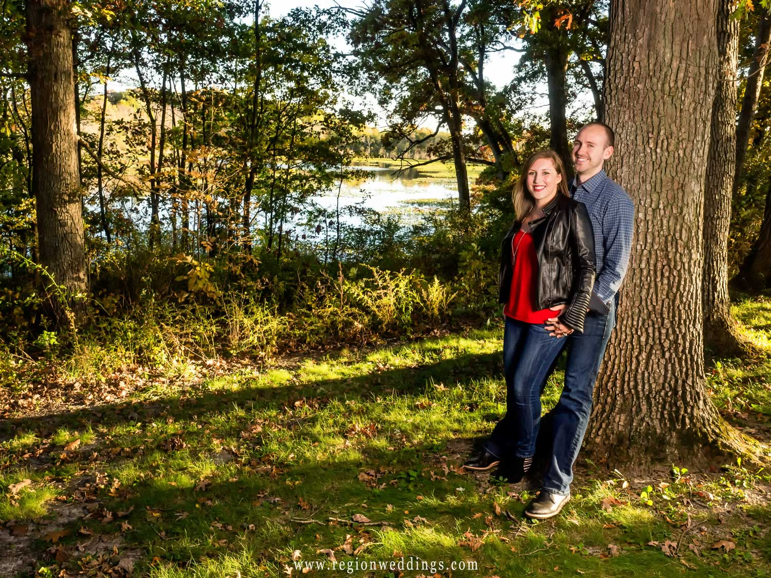 A couple in the woods for their Fall engagement photo.