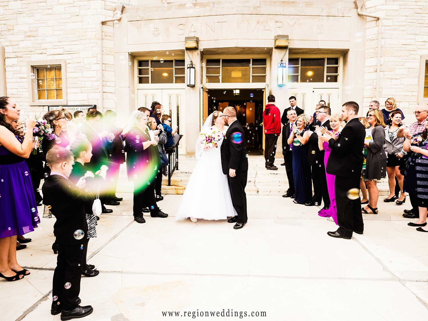 The newly married couple exits St. Mary's amid bubbles.