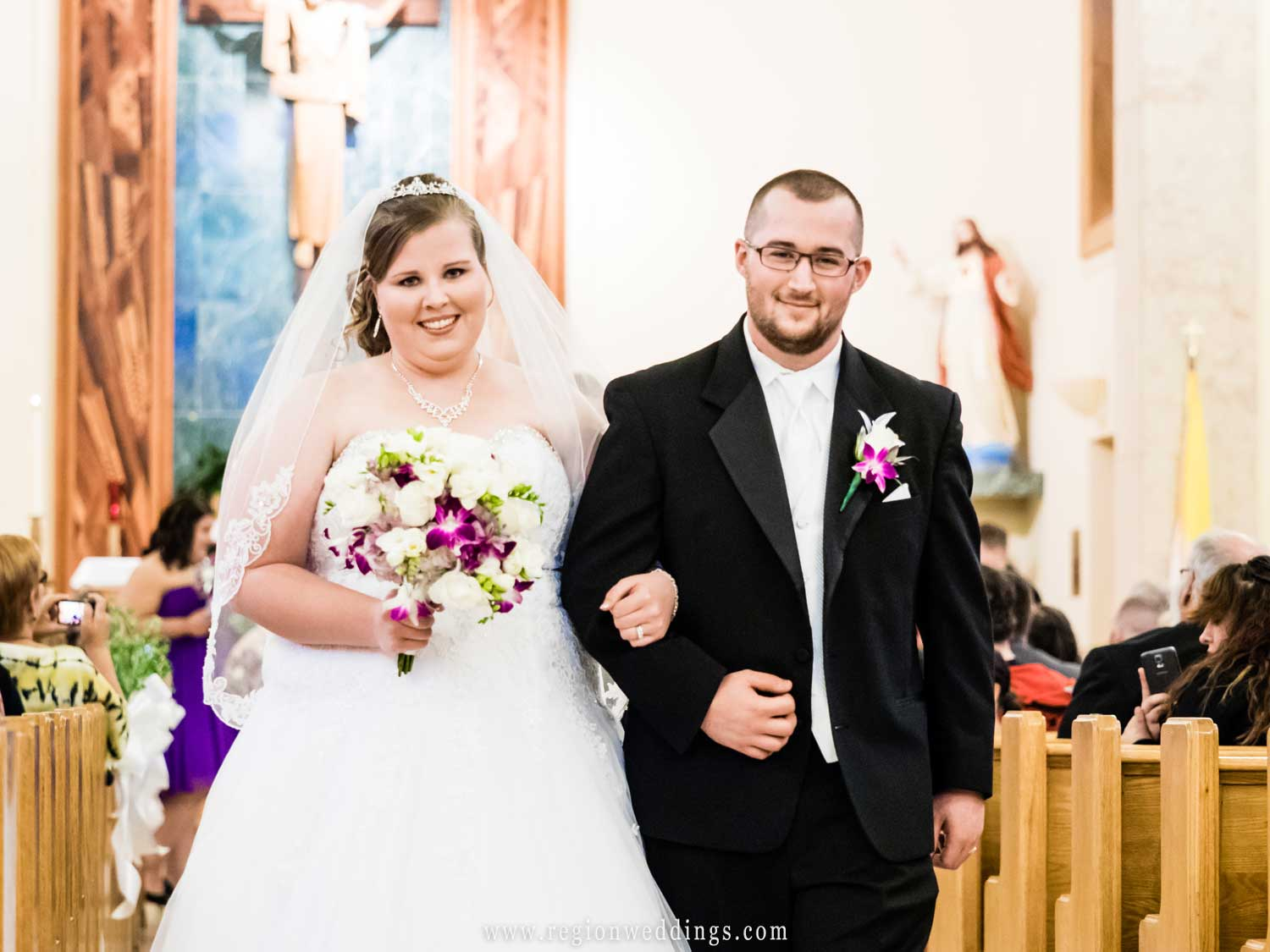 The newly married couple exits St. Mary's Church.