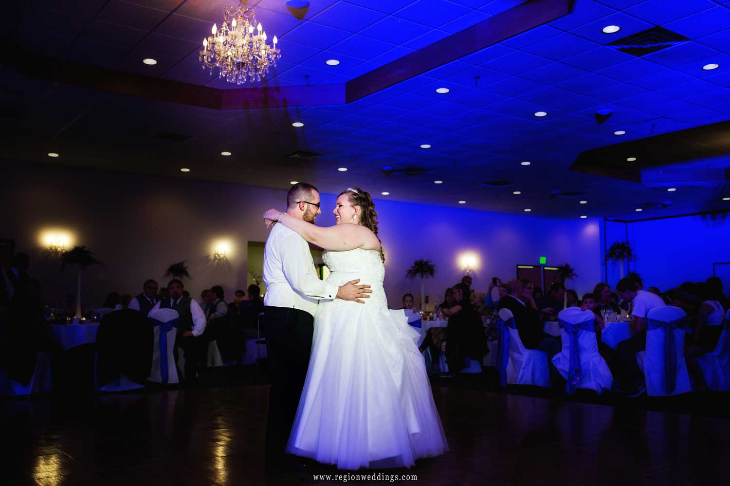First dance awash with purple and blue uplighting.