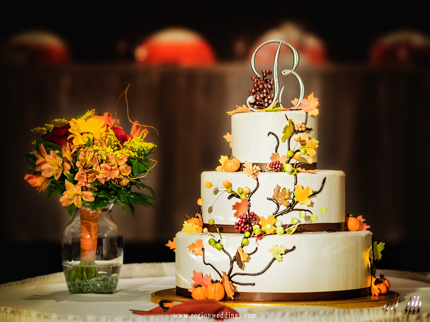 Wedding cake decorated for the Fall season.