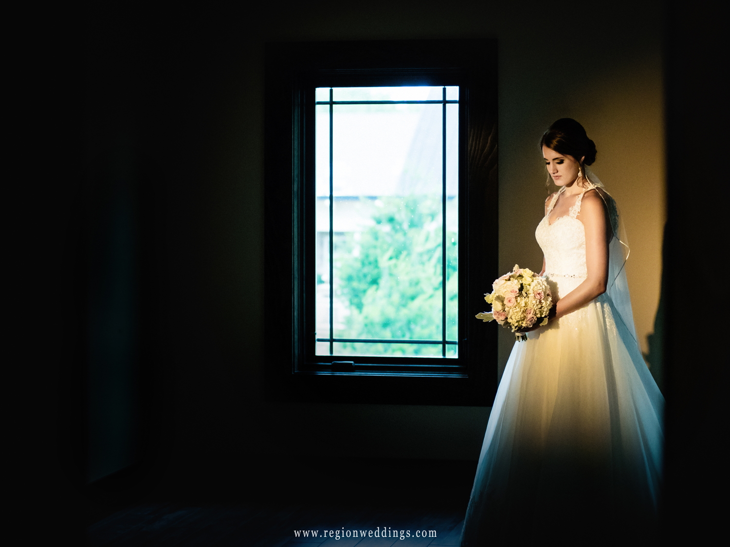 Bride alone on the second floor of the bridal suite at Sandy Pines.