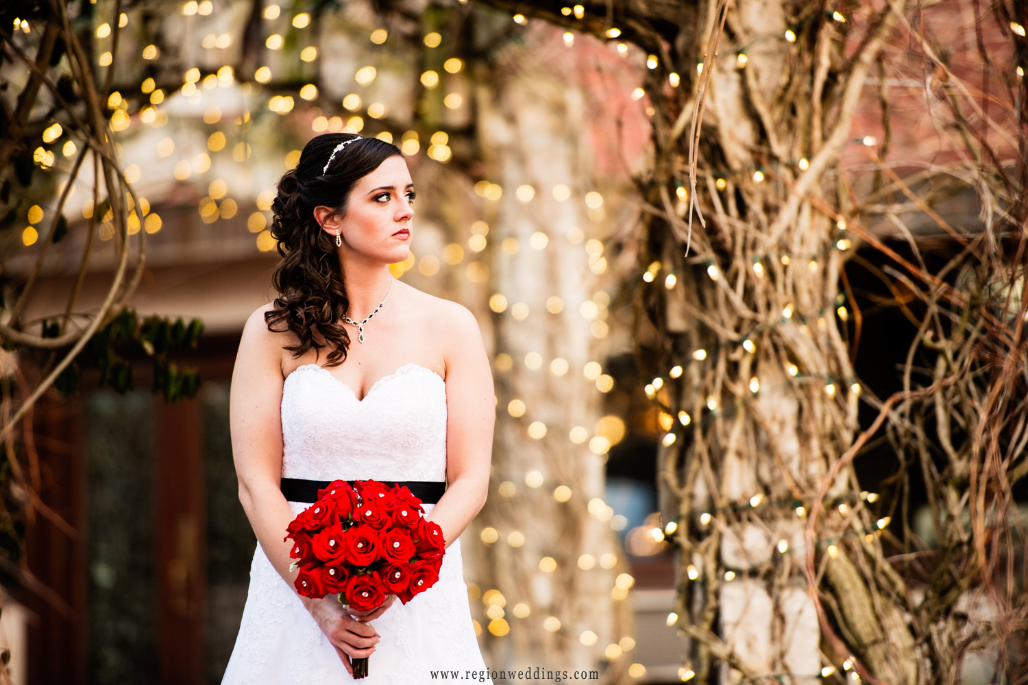 Bride walks along a lighted walkway at Meyer's Castle in Dyer, Indiana.