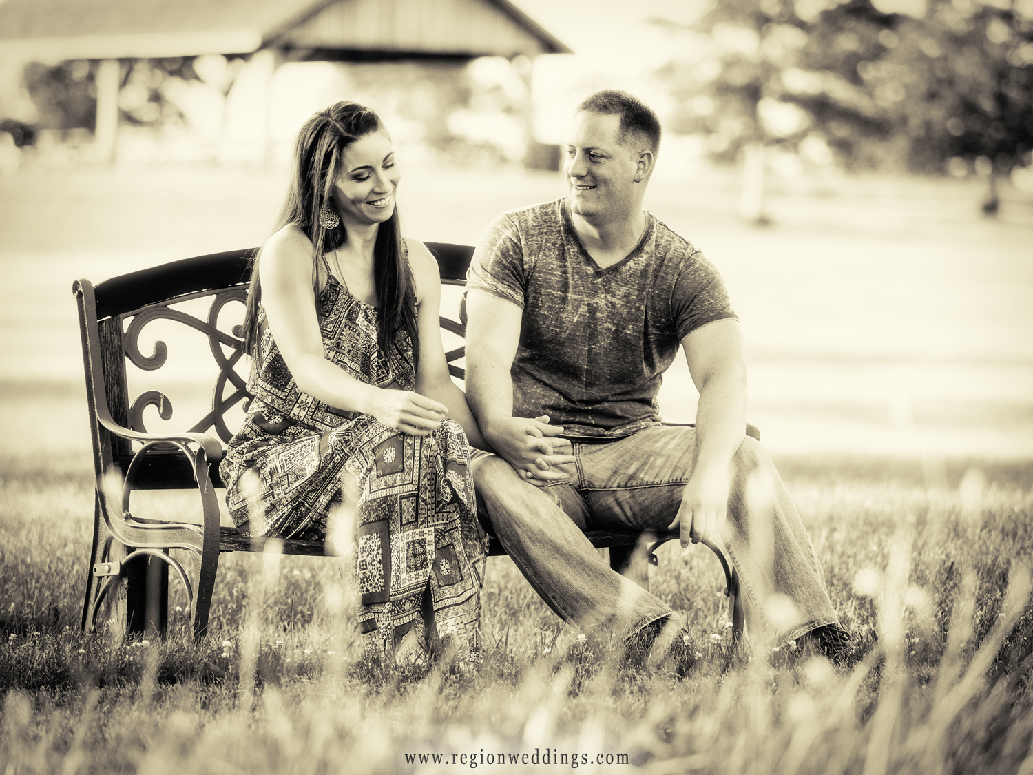 A couple sits on a bench at Buckley Homestead in Lowell, Indiana.