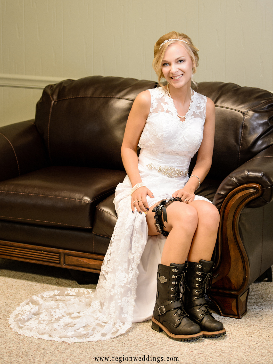 Bride shows off her Harley Davidson garter and boots.