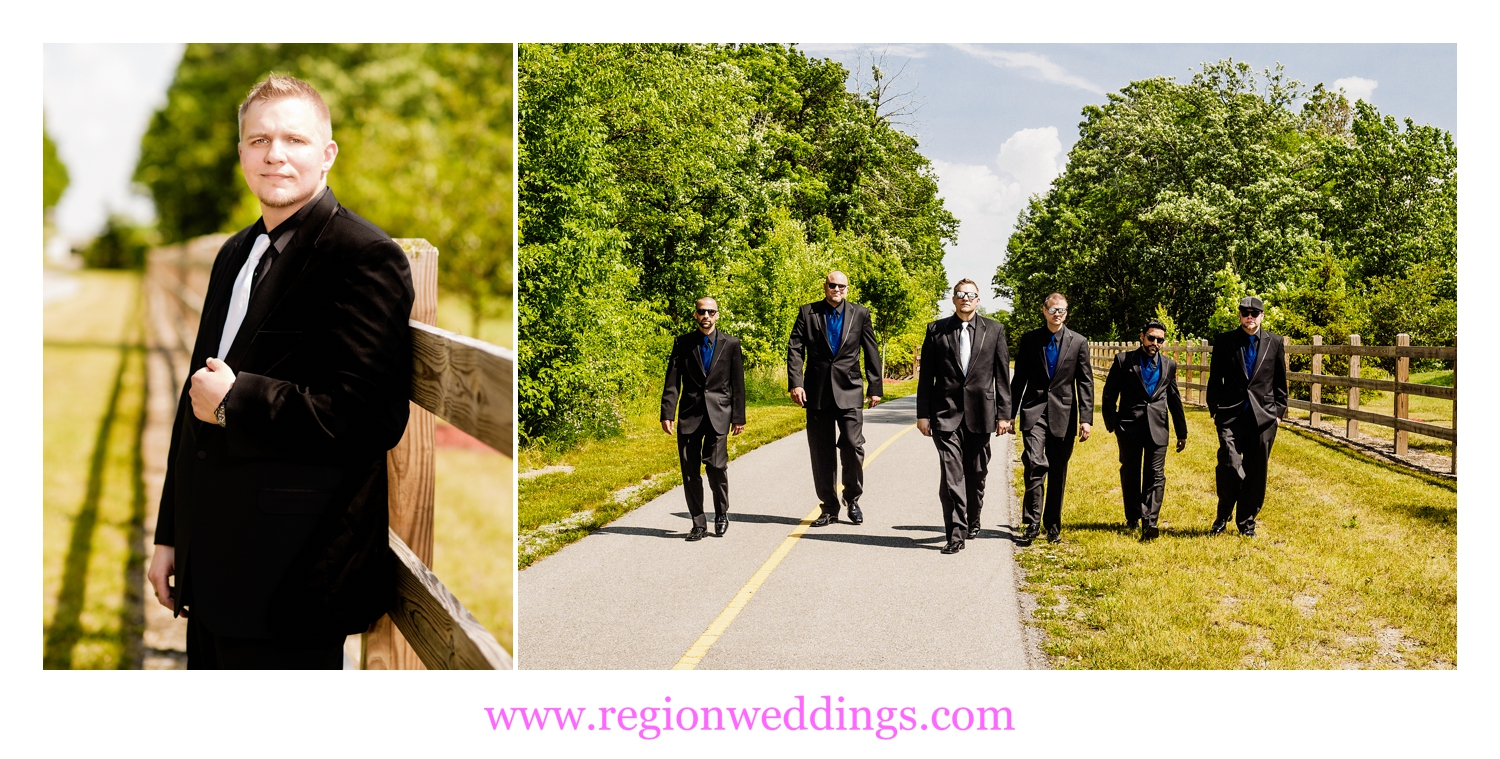 Groomsmen walk along the path at The Patrician Banquet Center.