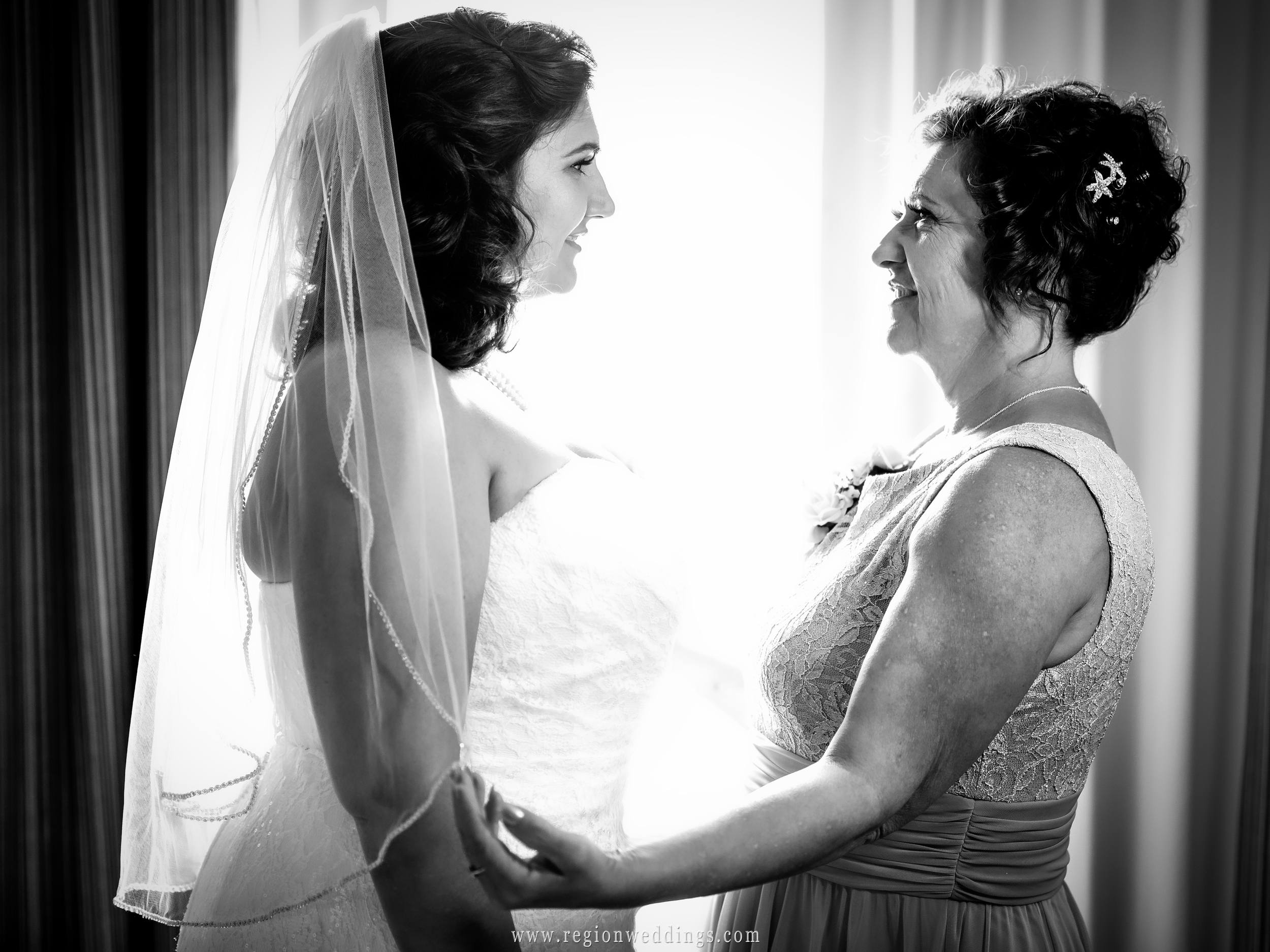 The bride and her mom share an emotional moment on wedding day.