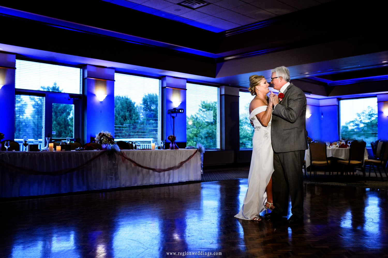 First dance for the bride and groom in the ballroom of Sand Creek Country Club.