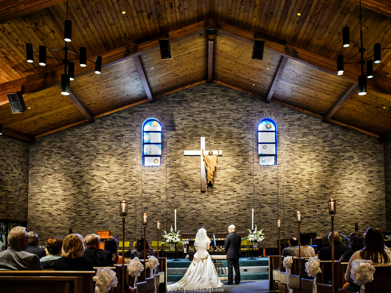 Summer wedding ceremony inside Saint Maria Goretti Church.
