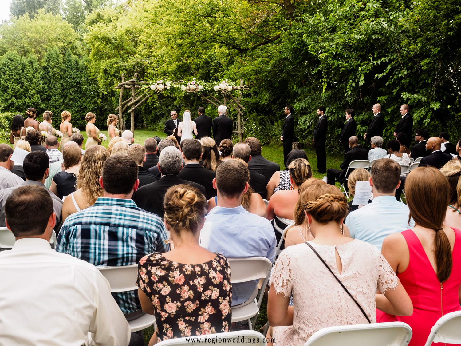 A summer wedding ceremony at County Line Orchard in Hobart, Indiana.