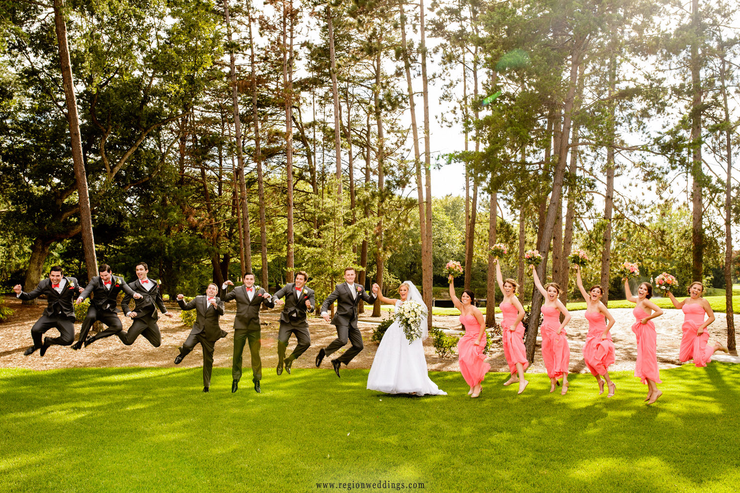 Wedding party jumping shot at Sandy Pines Golf Course.