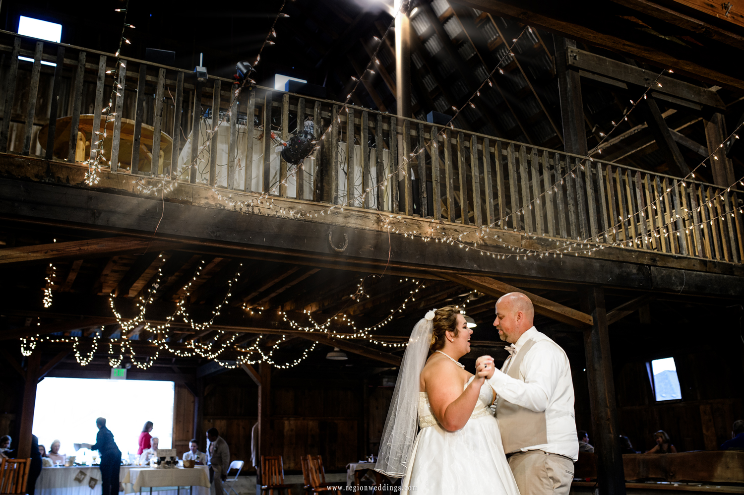 First dance inside the rustic red barn in Crown Point, Indiana.